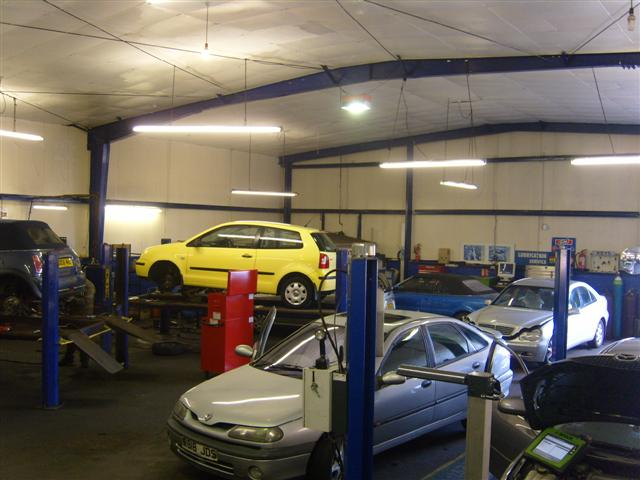inside the garage with yellow and silver car